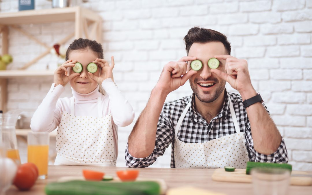 Father Daughter with cucumbers on eyes