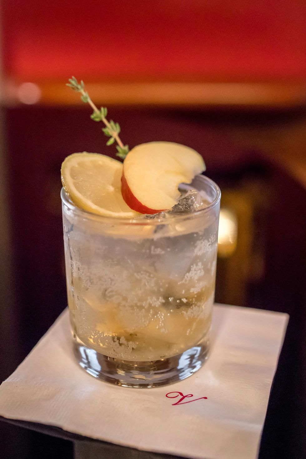gin apple fiz cocktail glass with apple