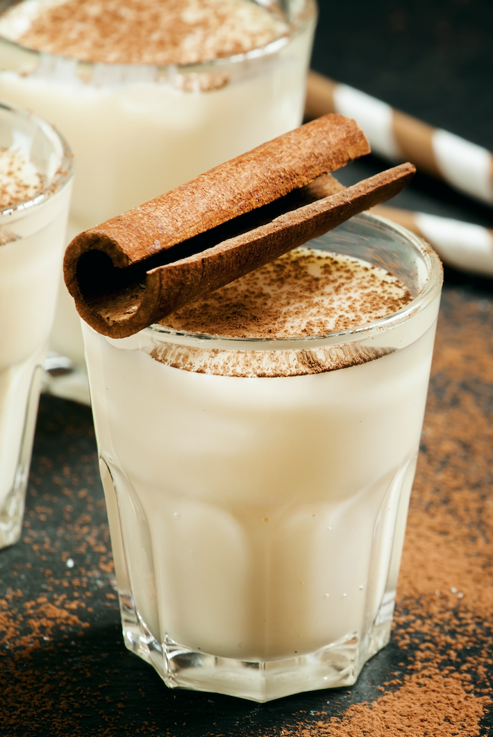 north pole nog spiced eggnog in glass with cinnamon stick