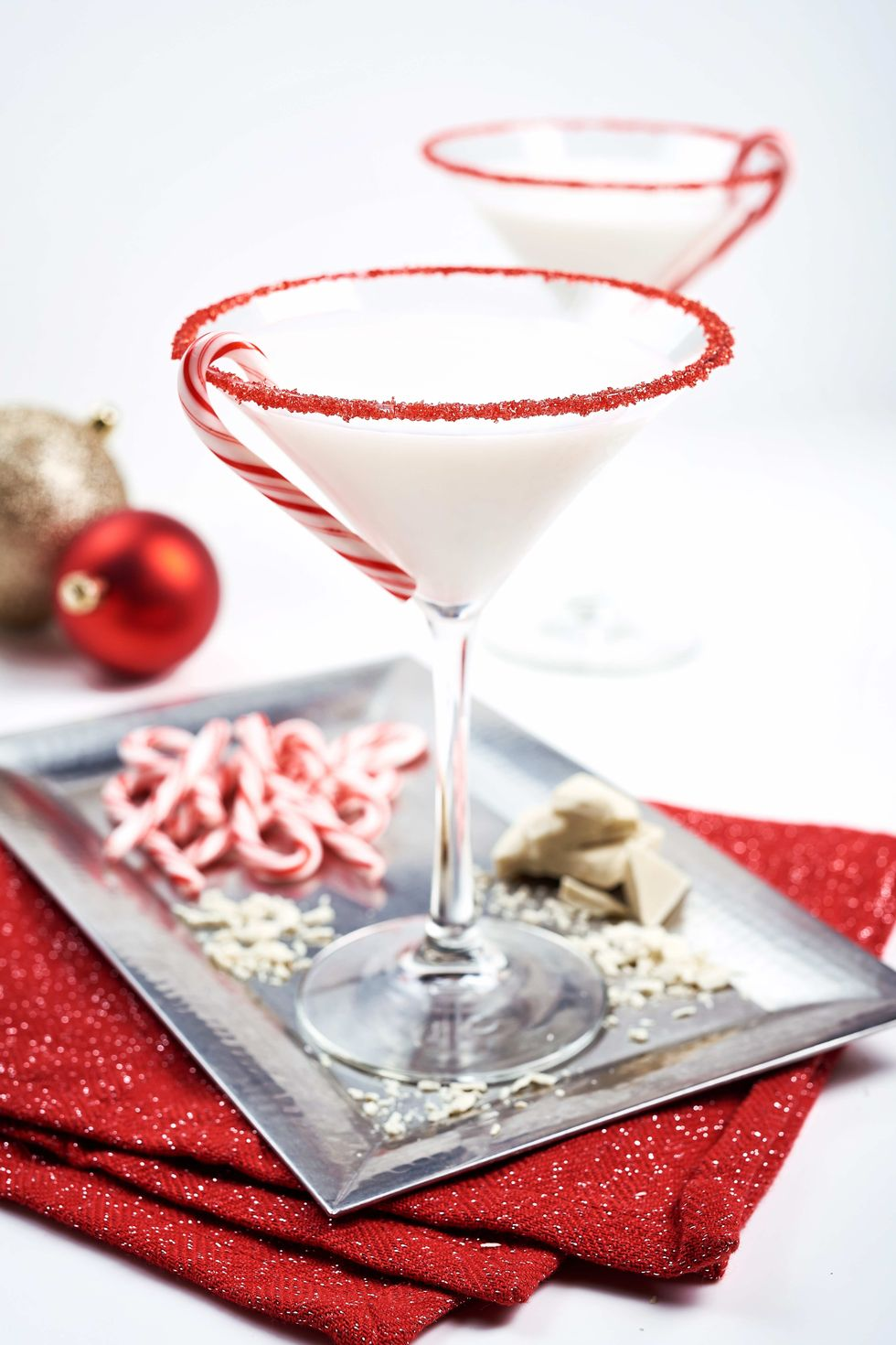 peppermind winter wonderland christmas holiday cocktail in maritini glass