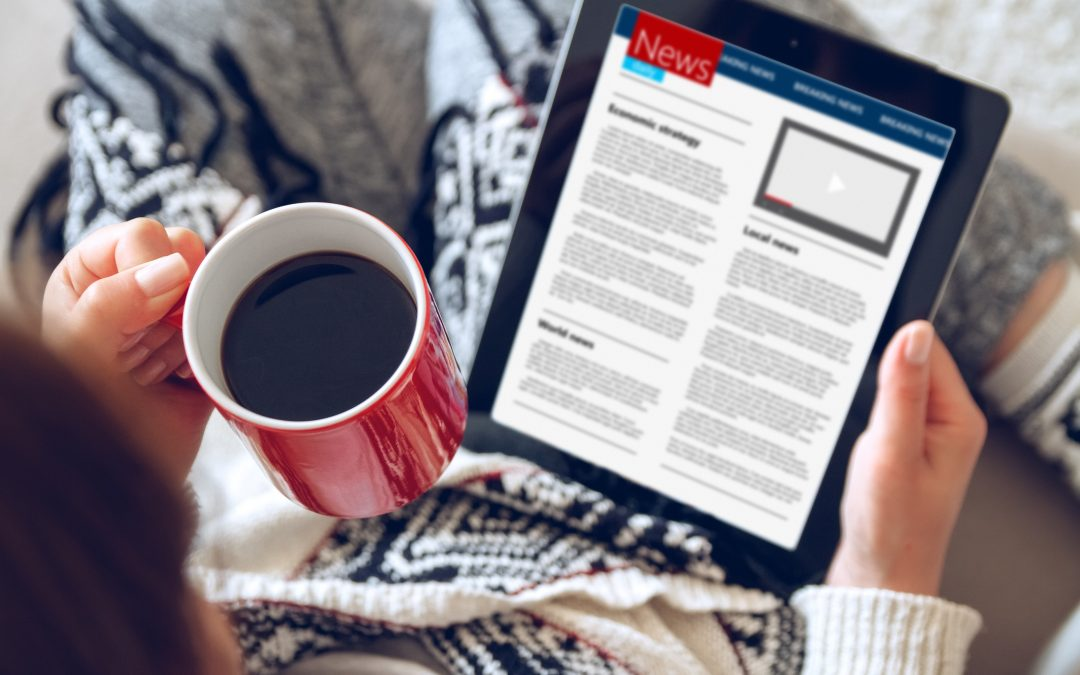 reading news online with coffee digital advertising