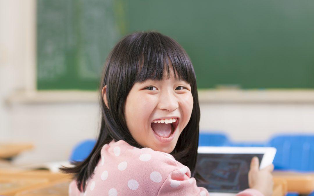 Happy,Little,Girl,Holding,Digital,Tablet,Ipad back to school shopping advertising digital trends