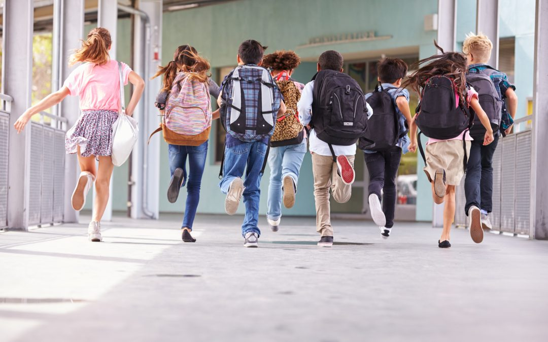 Group,Of,Elementary,School,Kids,Running,At,School,,Back,View back to school advertising